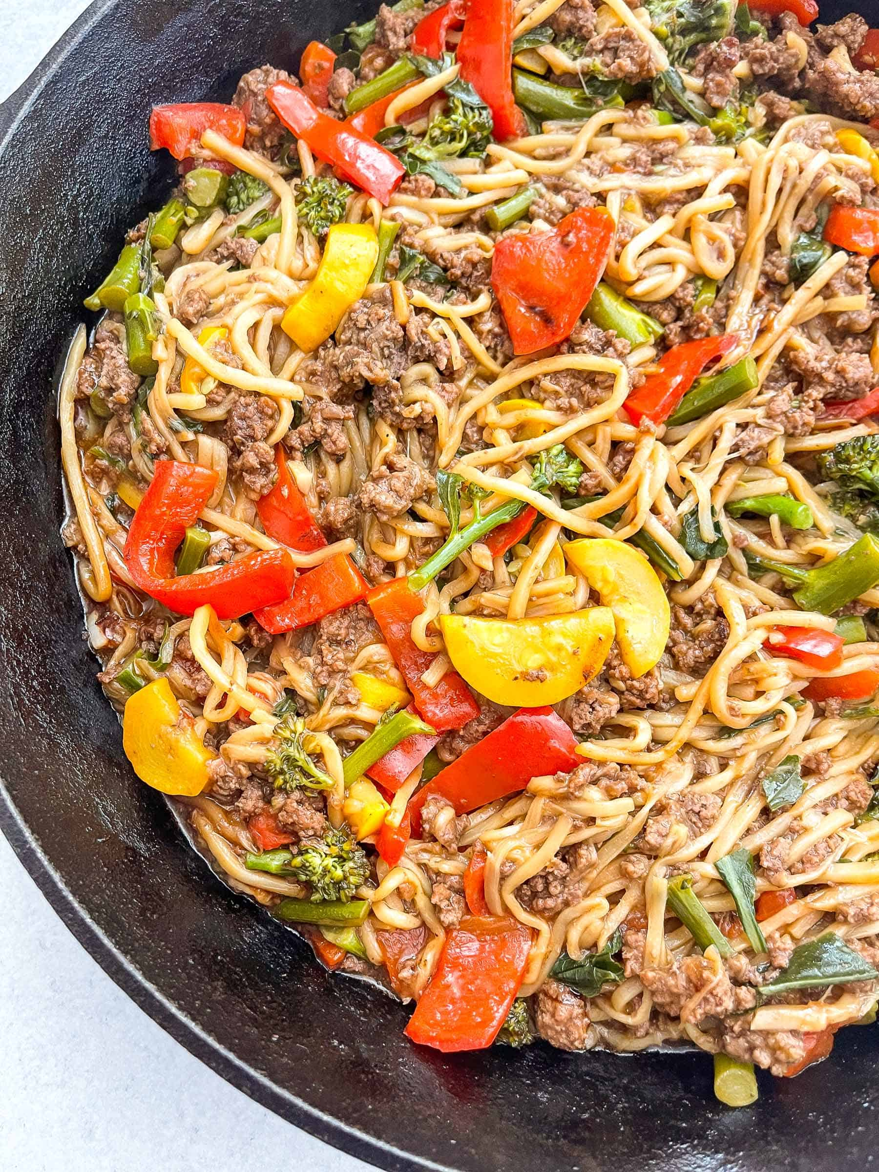 keto beef and vegetable noodle stir fry in a cast iron skillet