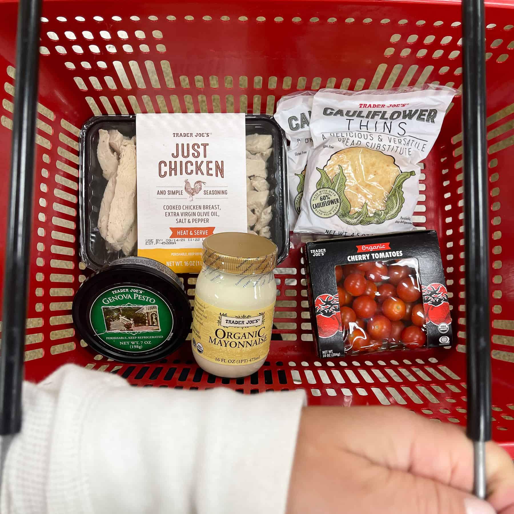 ingredients for keto pesto chicken salad in a red trader joe's basket