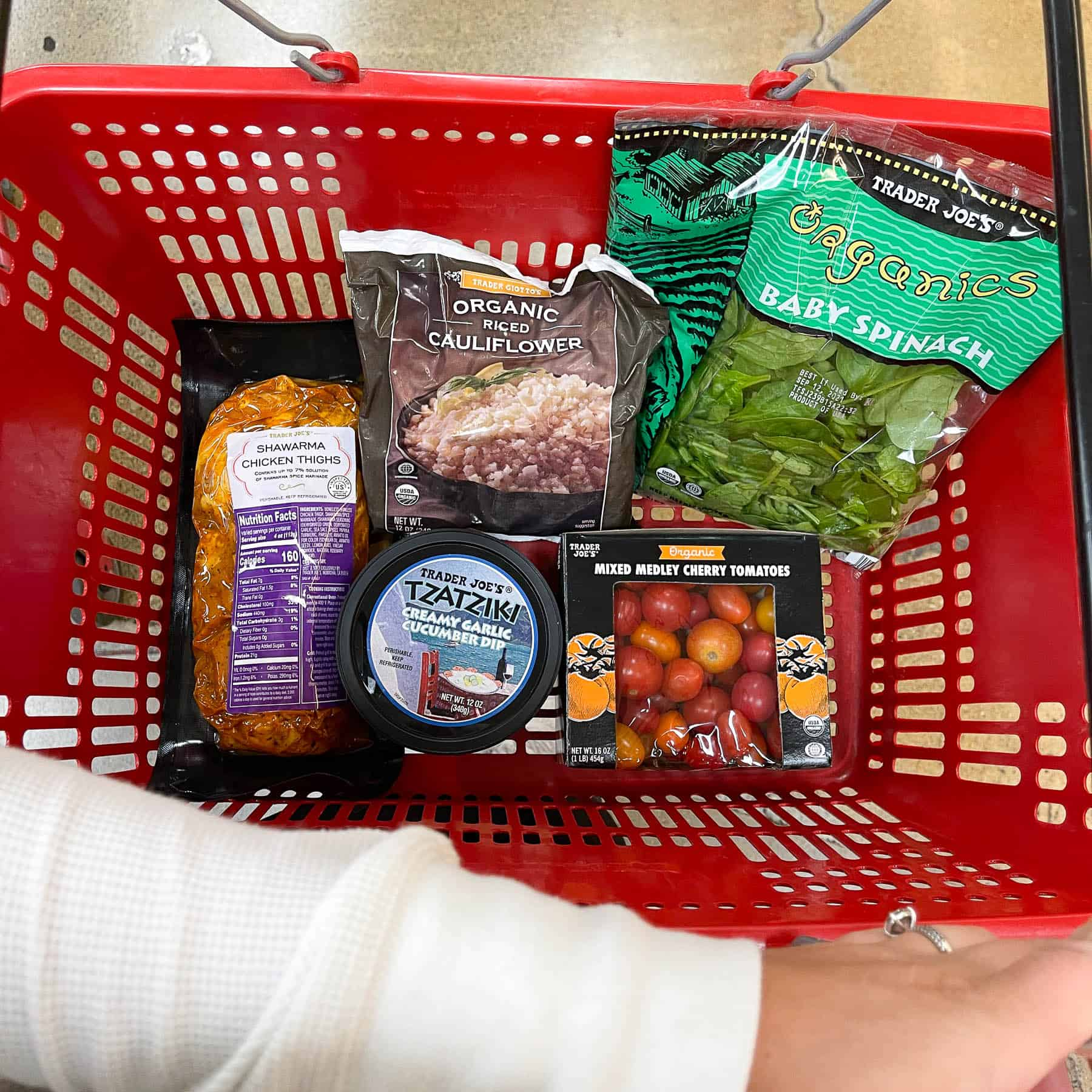 ingredients for keto sheet pan chicken shawarma bowls in a red trader joe's basket
