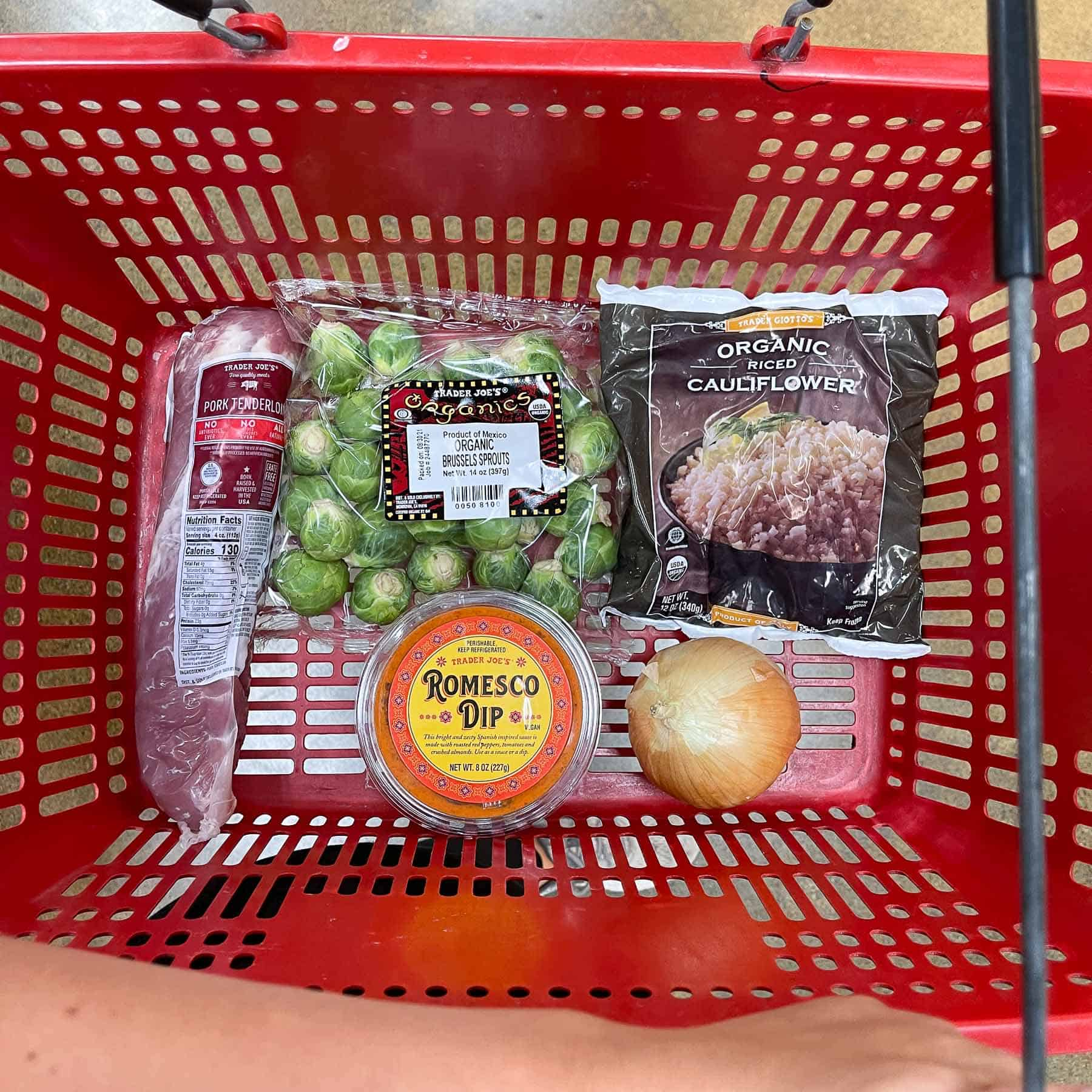 ingredients for keto sheet pan pork tenderloin with romesco in a red Trader Joe's basket