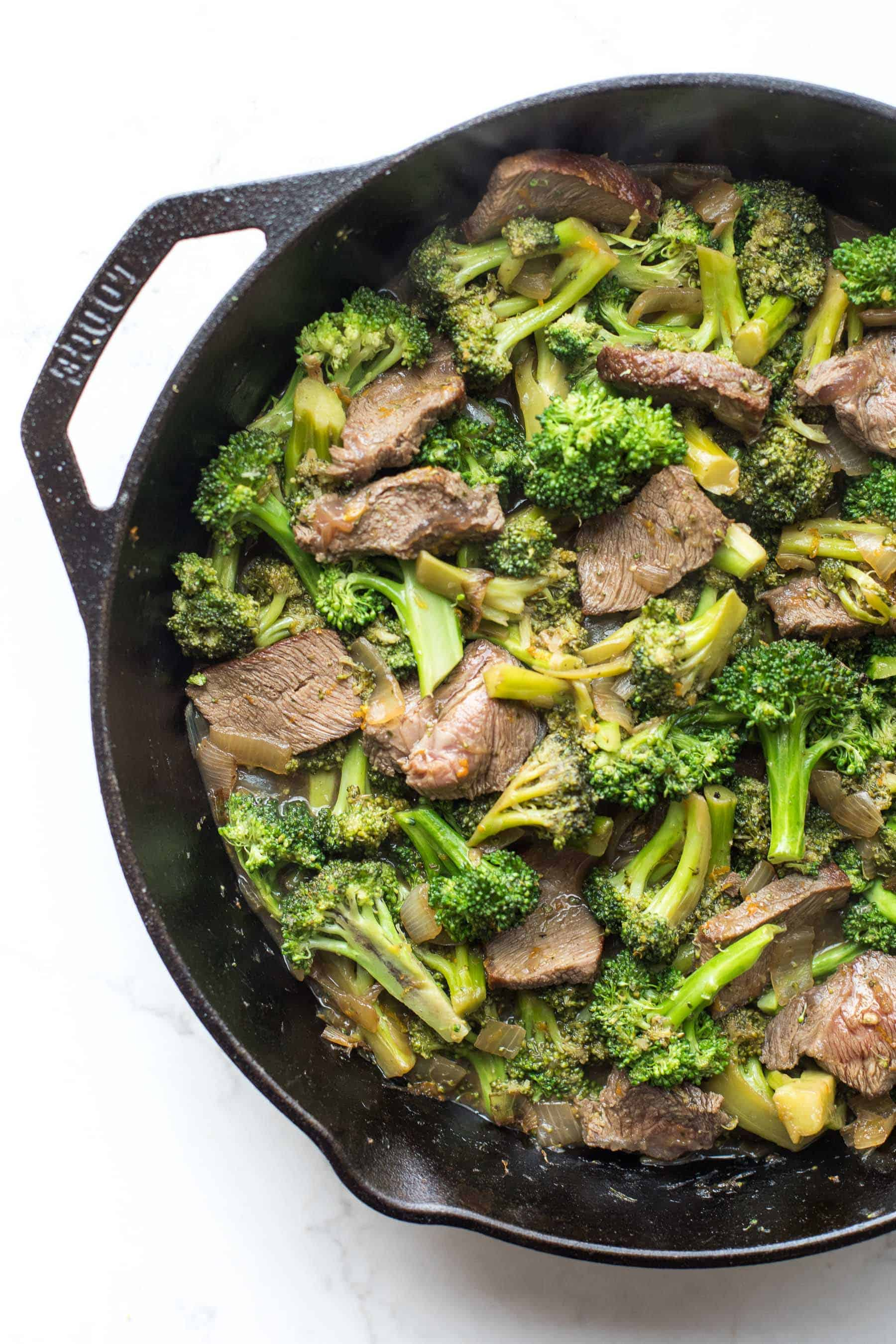 broccoli beef in a cast iron skillet