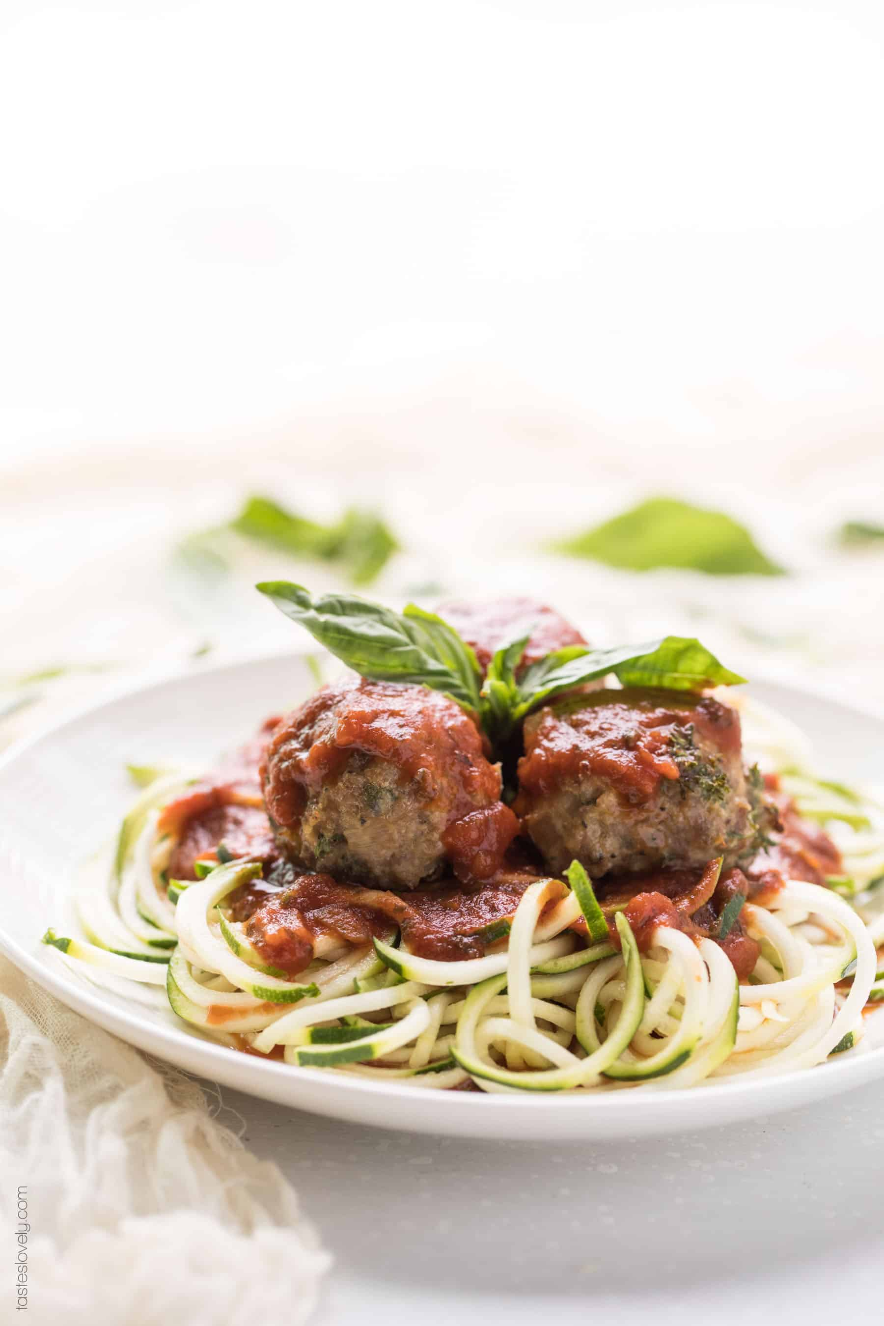 meatballs on a plate with zucchini noodles