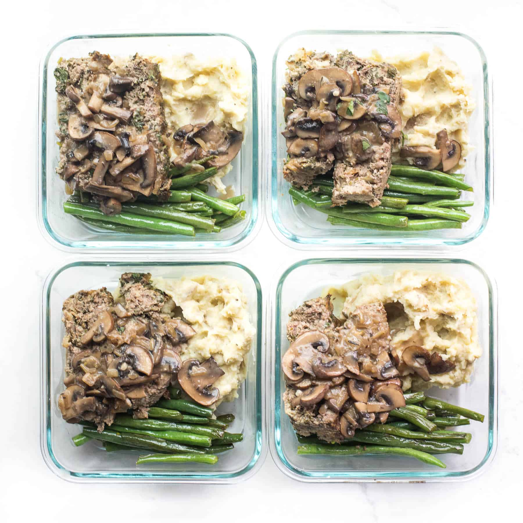 meal prep containers with meatloaf, mashed potatoes and green beans