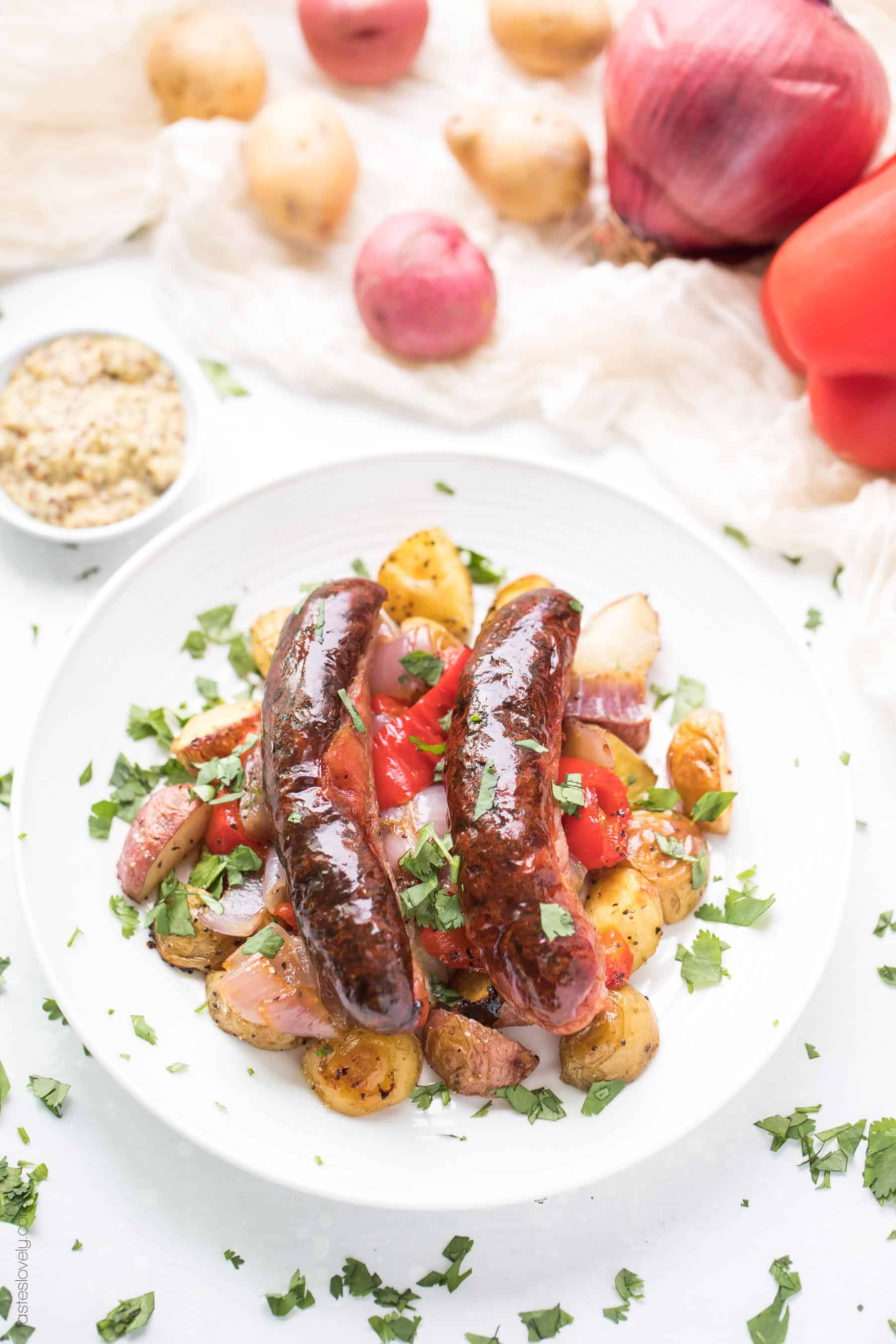 Paleo + Whole30 Sheet Pan Sausage, Bell Pepper and Potato Roast - a super quick and healthy breakfast or dinner recipe! Just 10 minutes of prep, and the oven does the rest of the work for you. #paleo #whole30 #glutenfree #grainfree #dairyfree #sugarfree #keto #cleaneating #realfood