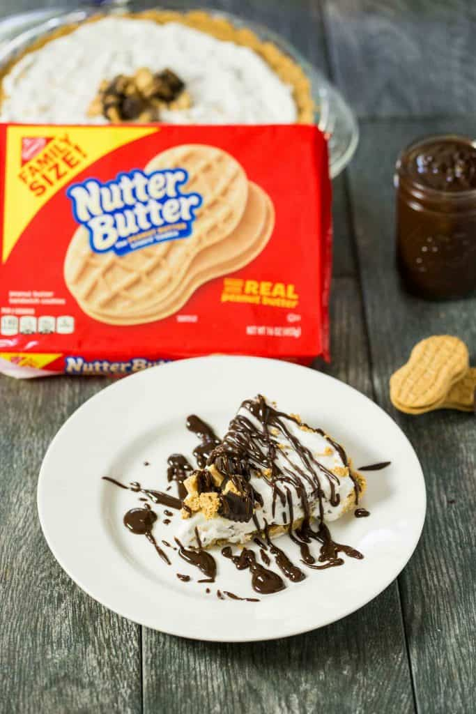 Peanut Butter Lovers Ice Cream Pie - a no bake dessert with a NUTTER BUTTER crust, vanilla and peanut butter cup ice cream filling, and a peanut butter chocolate sauce drizzled on top