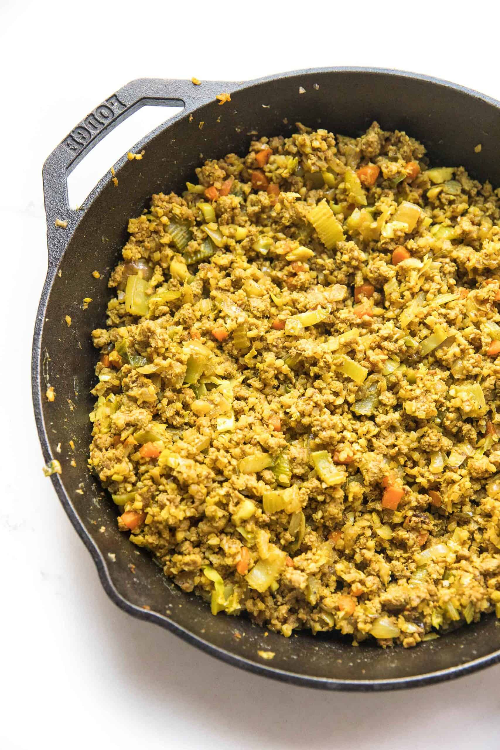 Curry lettuce wraps filling in a cast iron skillet
