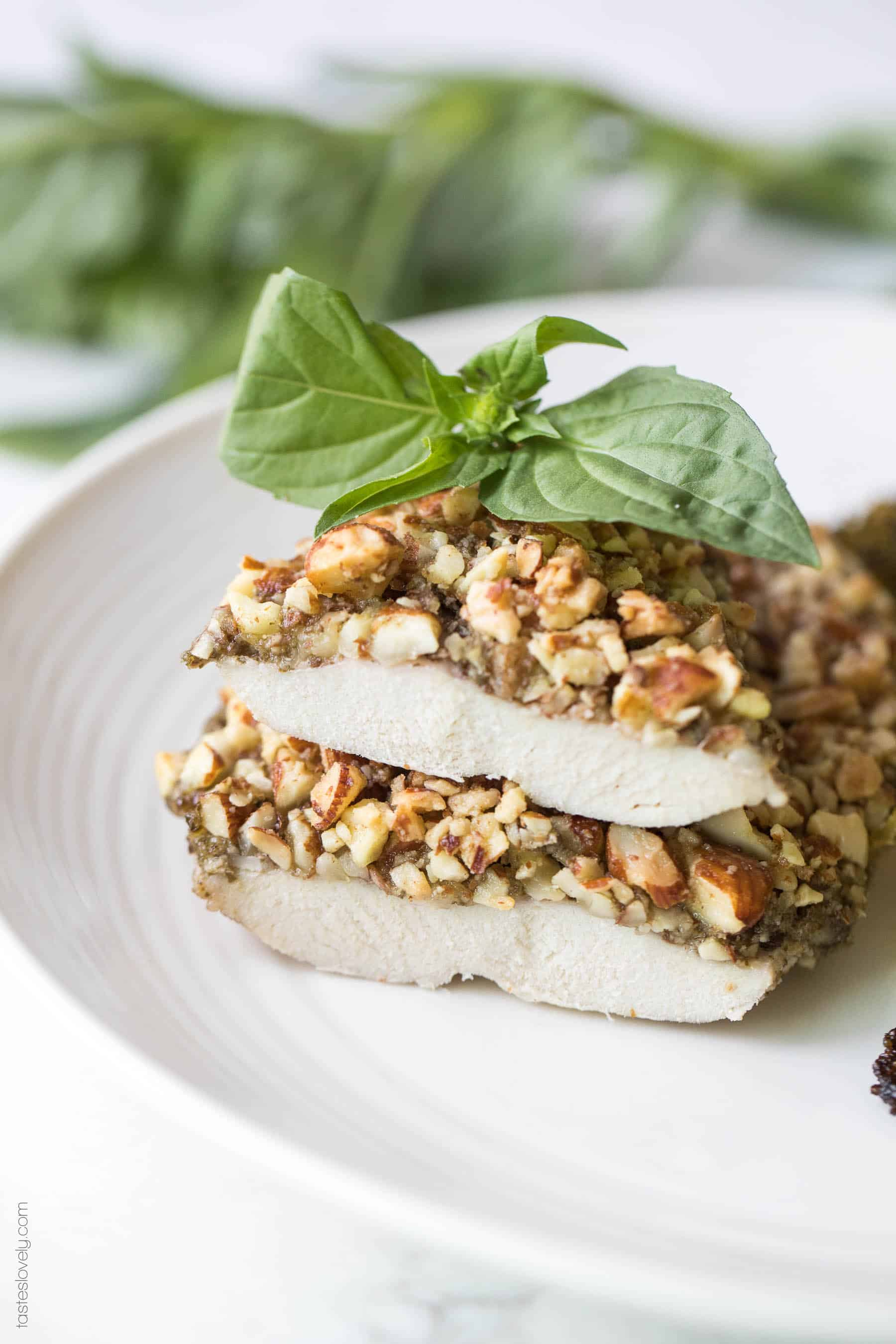 Paleo + Whole30 Almond Crusted Pesto Chicken - a quick and healthy 30 minute dinner recipe! #paleo #whole30 #glutenfree #grainfree #dairyfree #sugarfree #keto #cleaneating #realfood