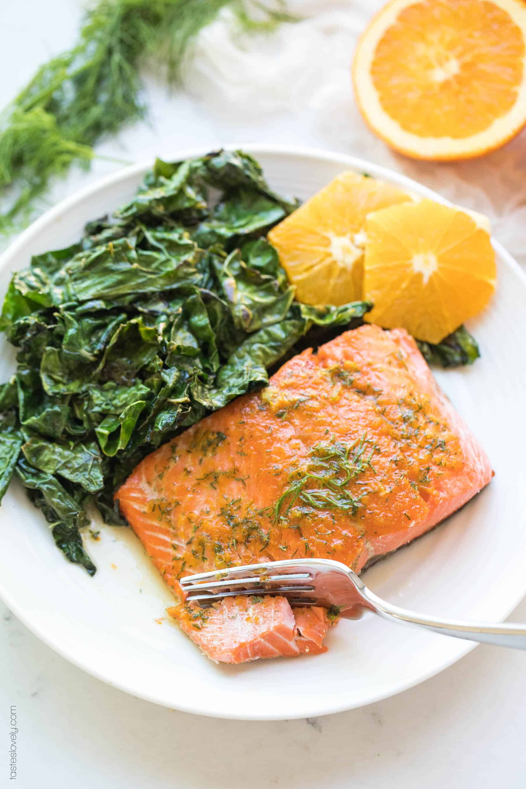Salmon with oranges and kale and butter