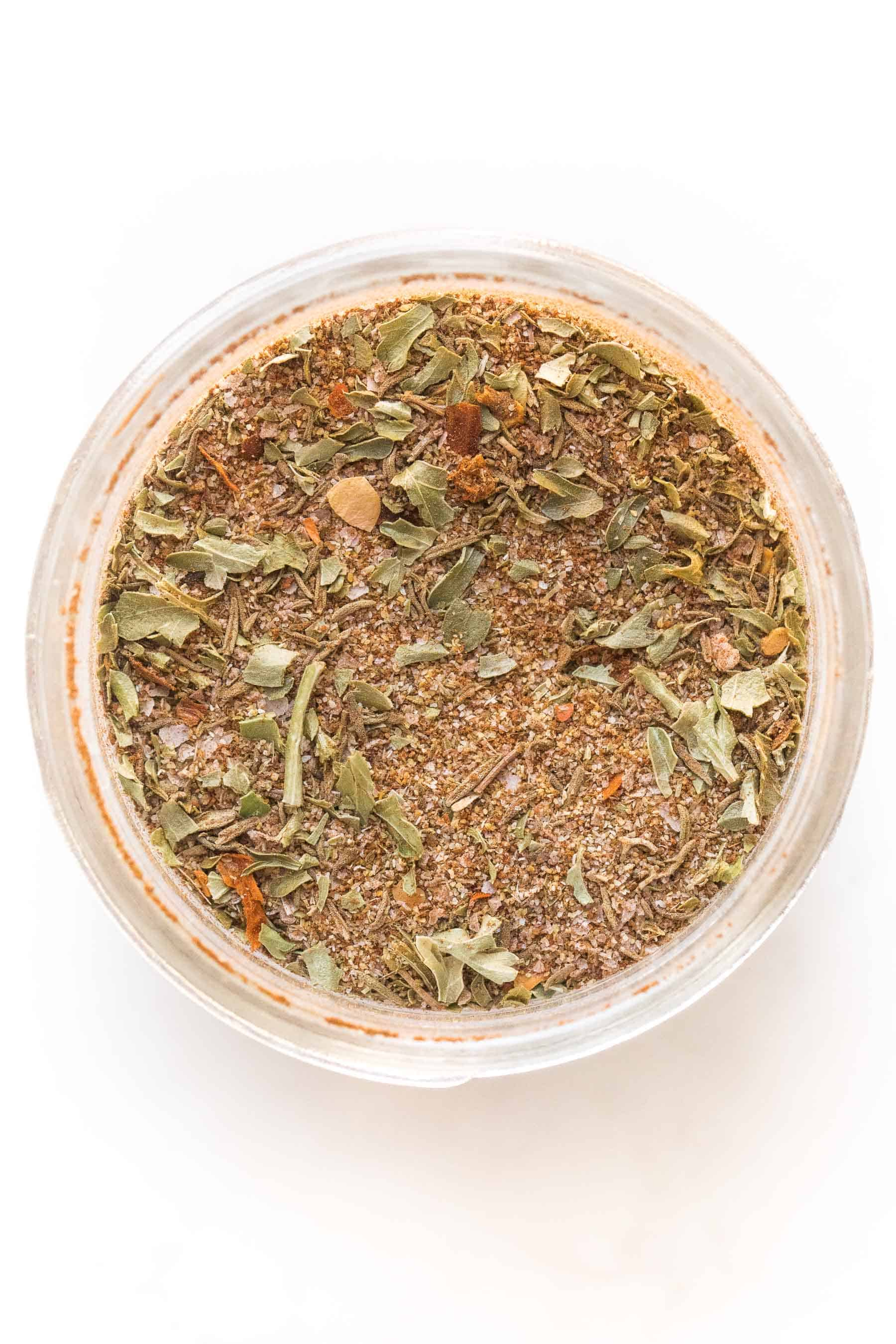 jamaican jerk seasoning in a mason jar on a white background
