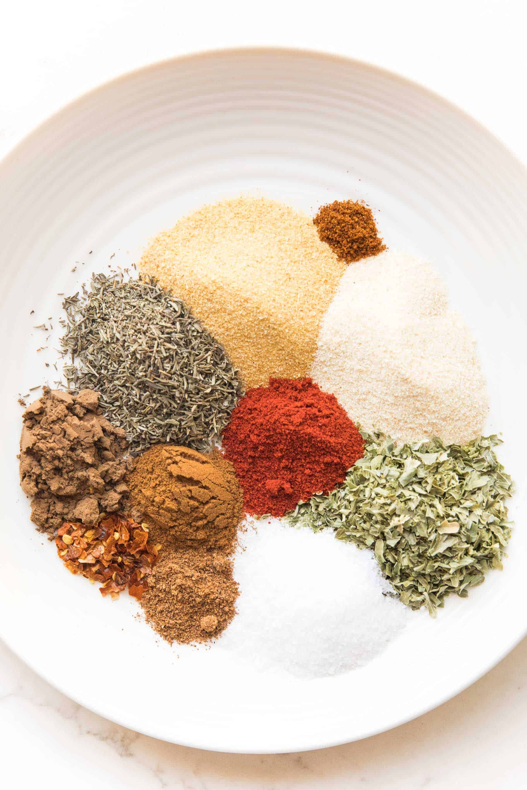 blend of spices for jamaican jerk seasoning on a white plate