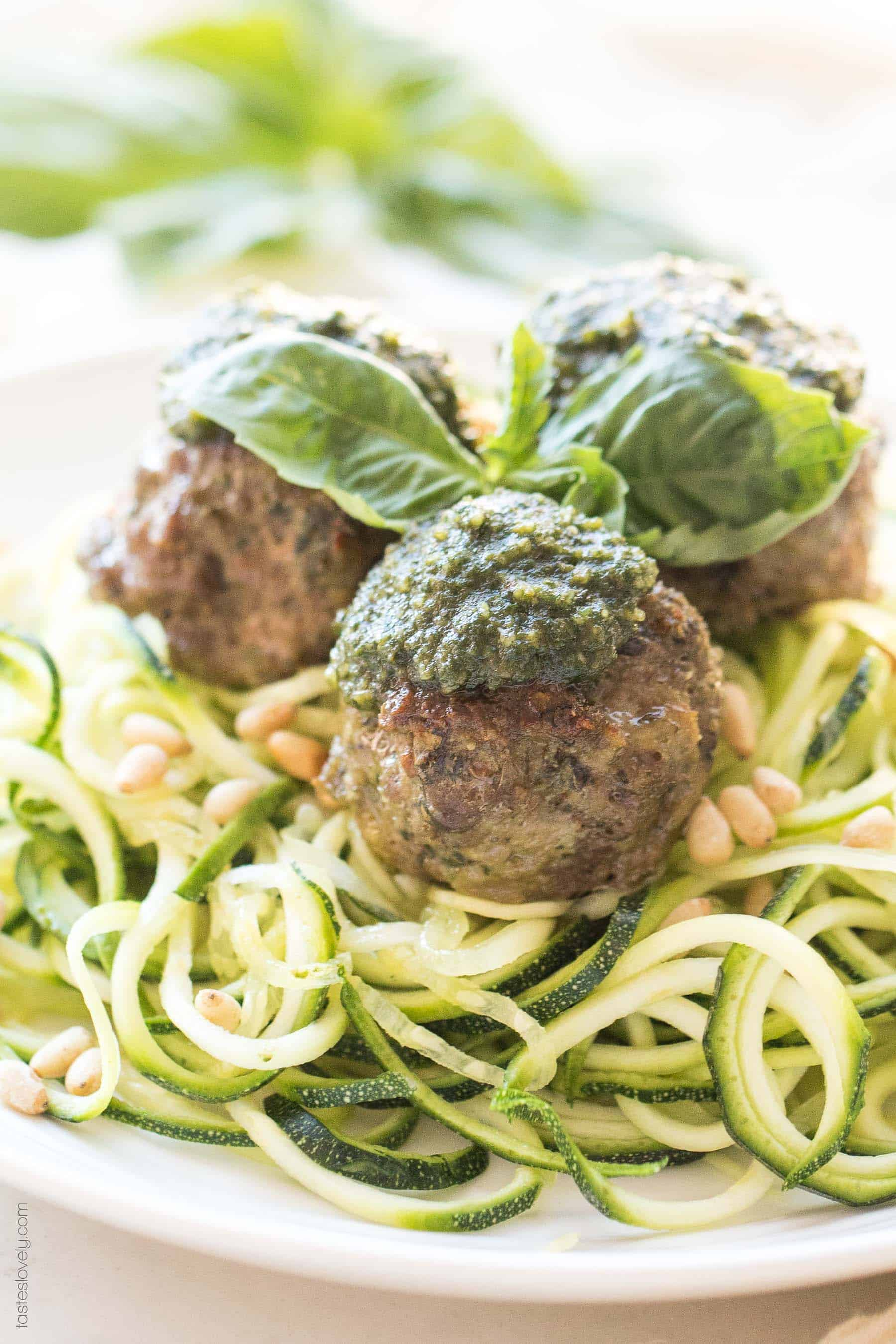 A plate of pesto meatballs on top of zucchini noodles
