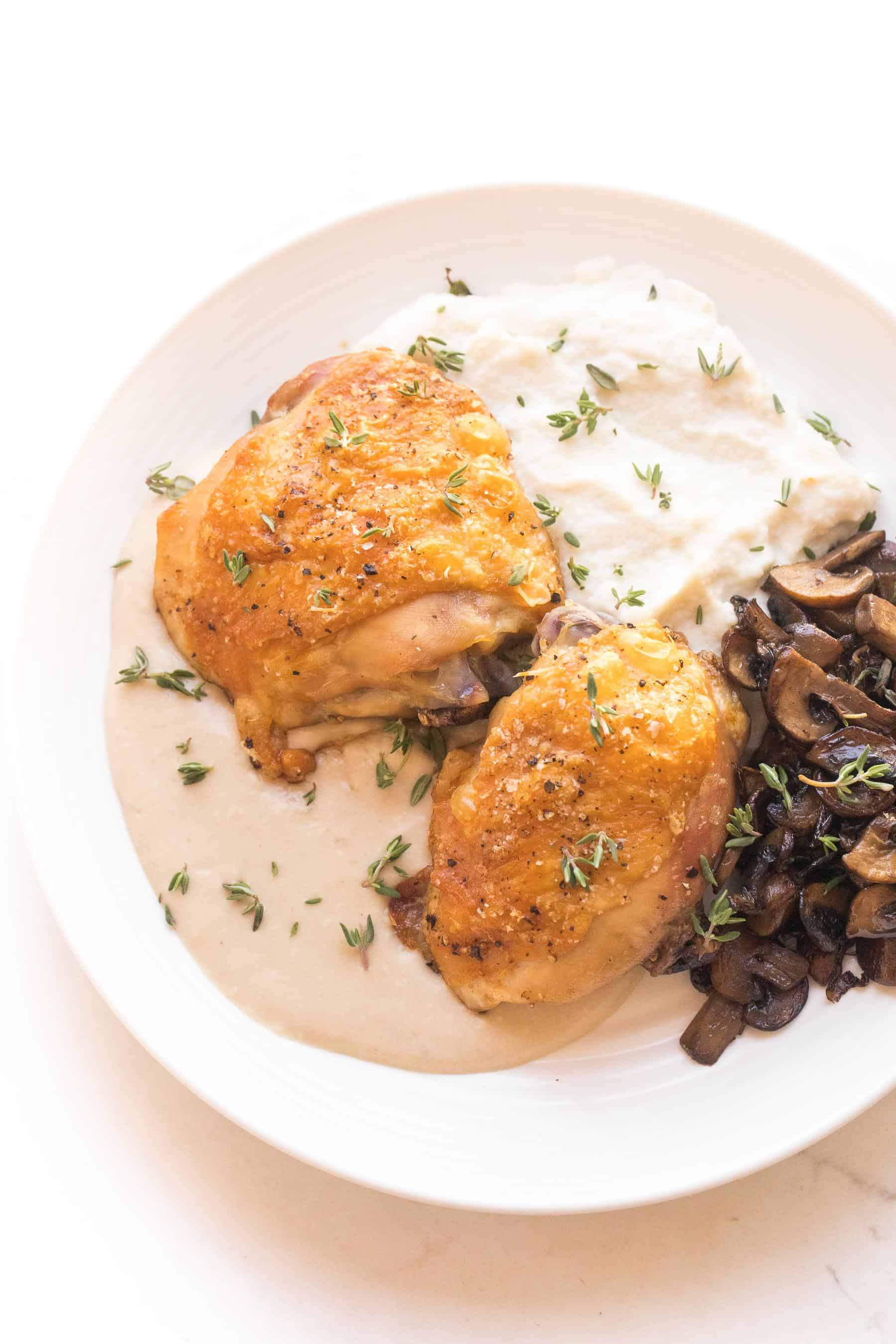 Crispy chicken thighs with mashed caulilfower + sauteed mushrooms with mustard sauce