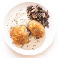 crispy chicken thighs with mashed cauliflower, sauteed mushrooms and creamy mustard sauce