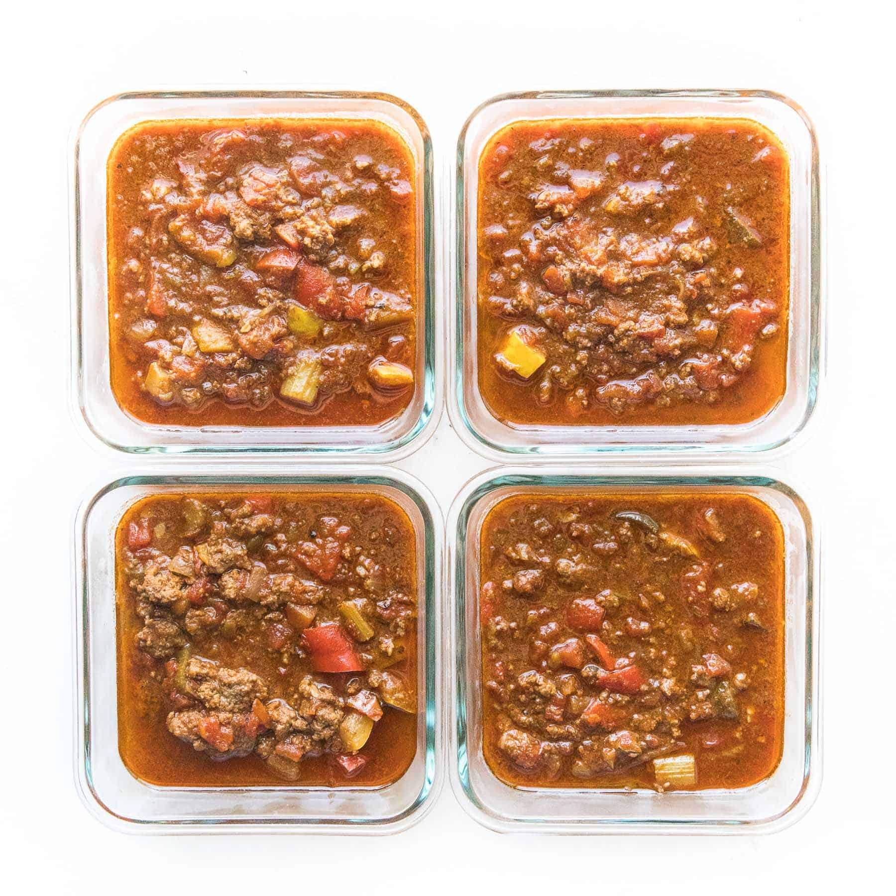 chili in meal prep containers on a white background