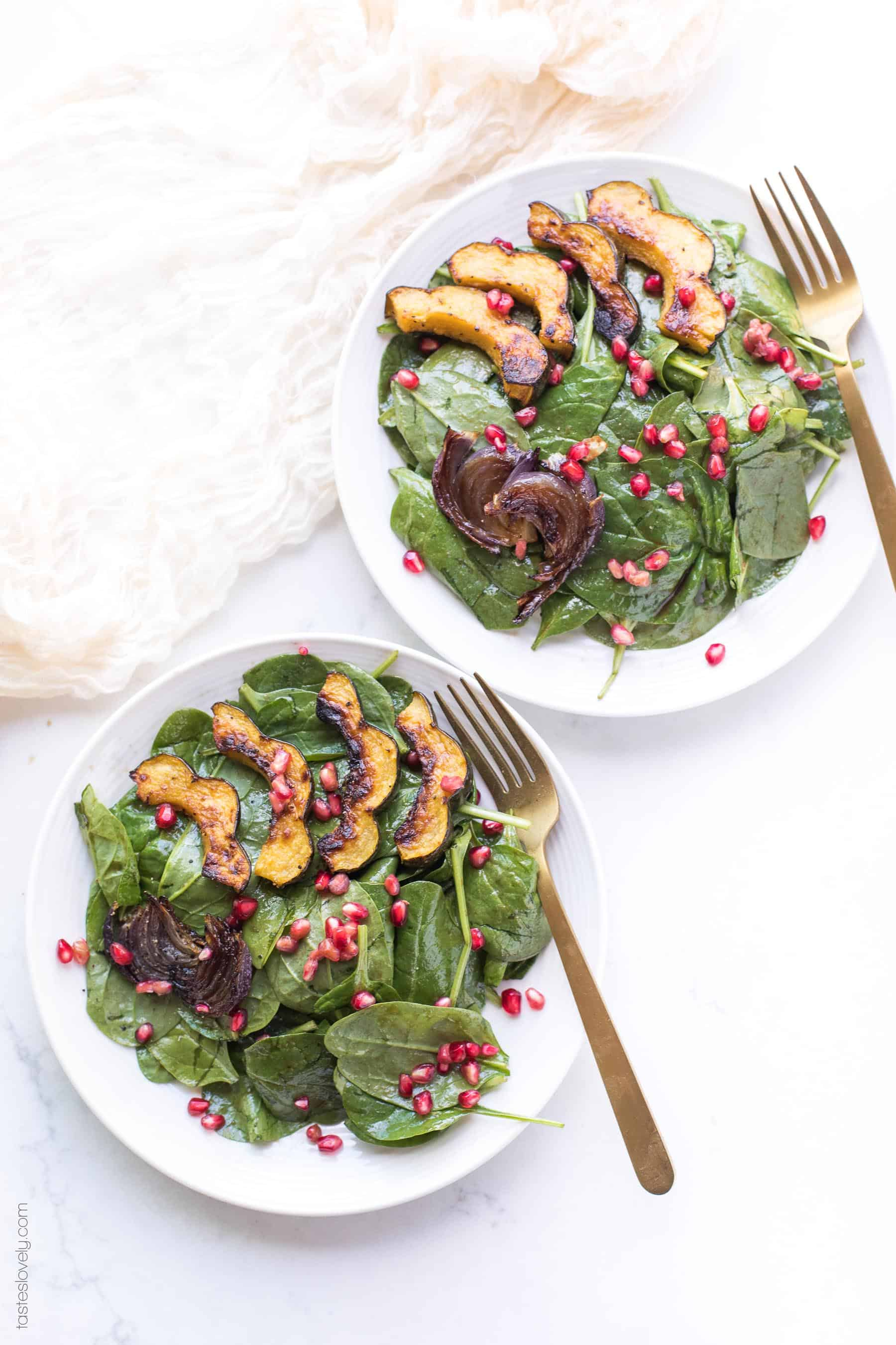 Spinach salad with roasted acorn squash, onions and pomegranates