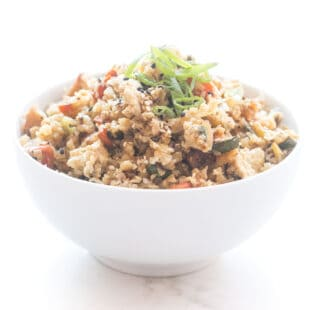 Whole30 + keto cauliflower fried rice in a white bowl