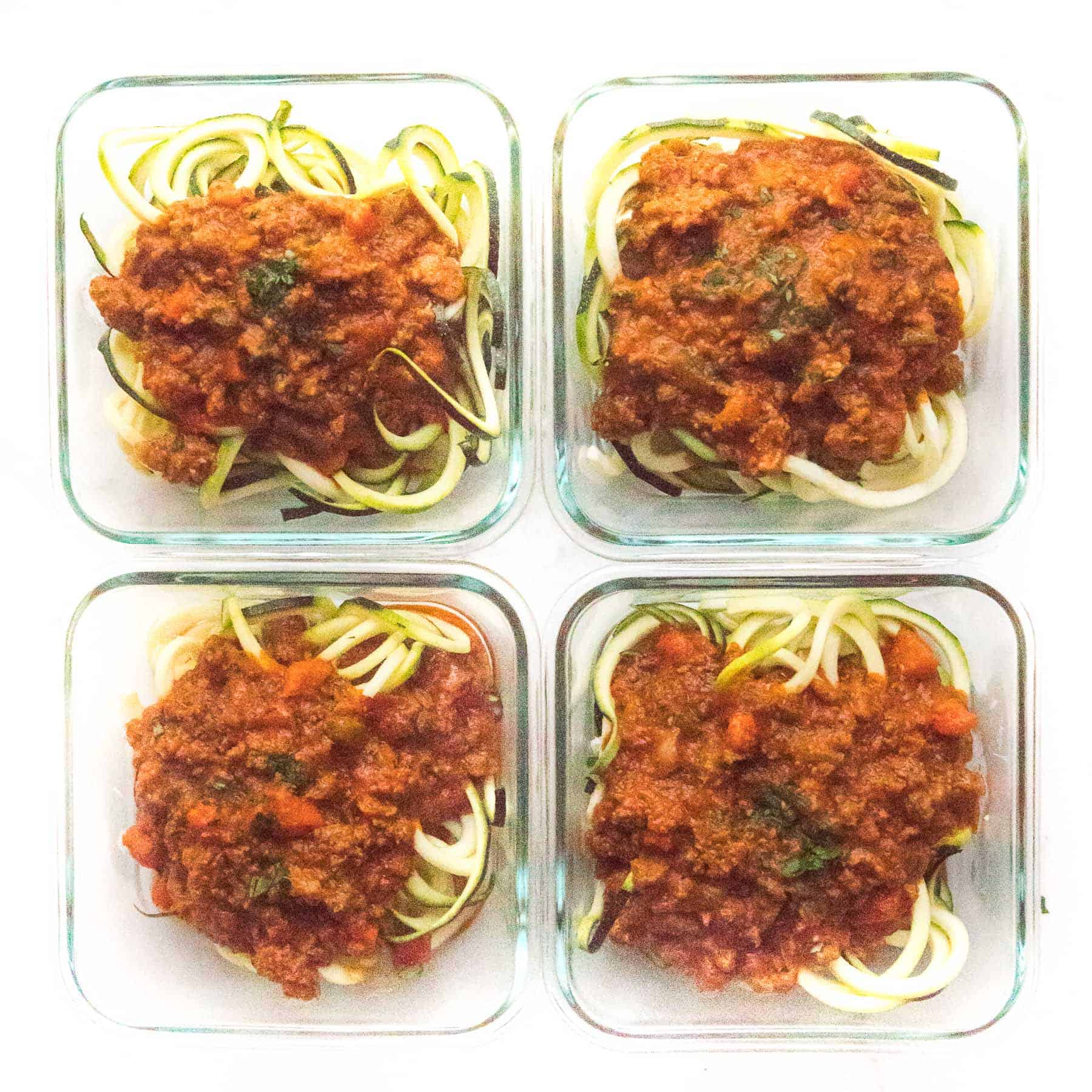 zucchini noodles with bolognese sauce in meal prep containers