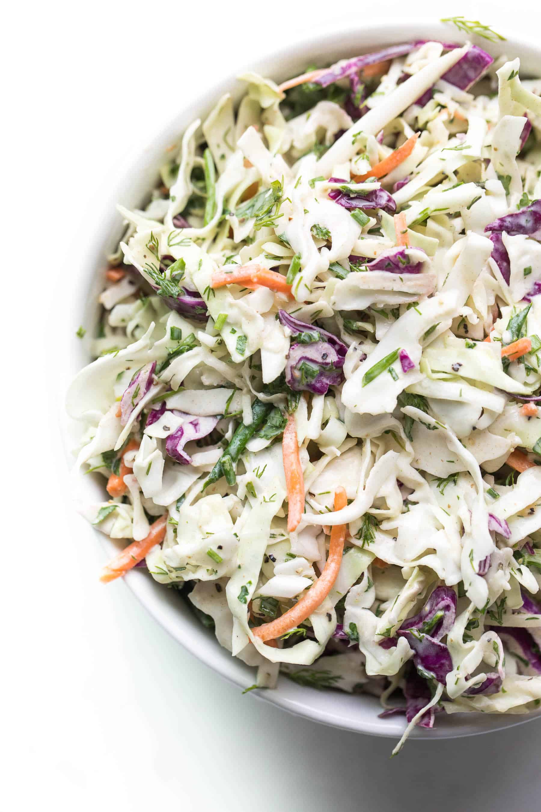 Herby lemon coleslaw in a white bowl