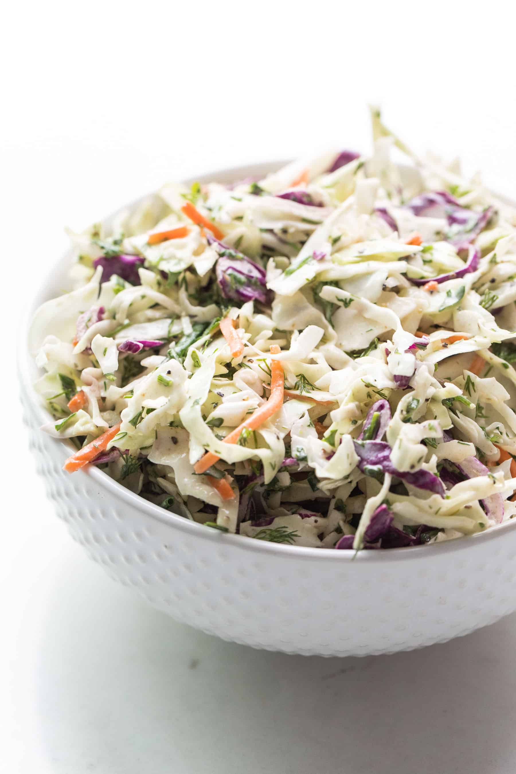 Coleslaw in a white bowl
