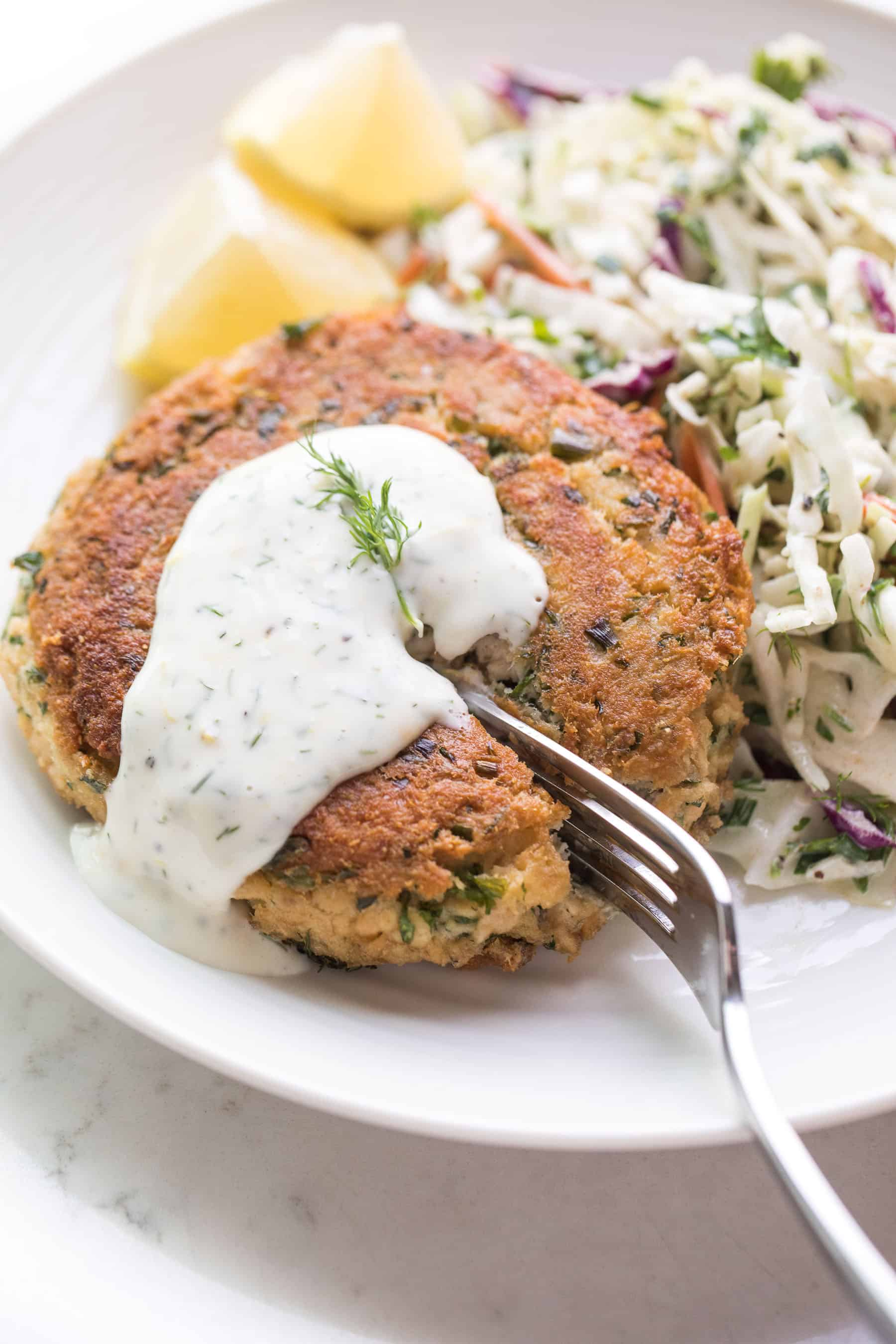A fork cutting into a salmon cake