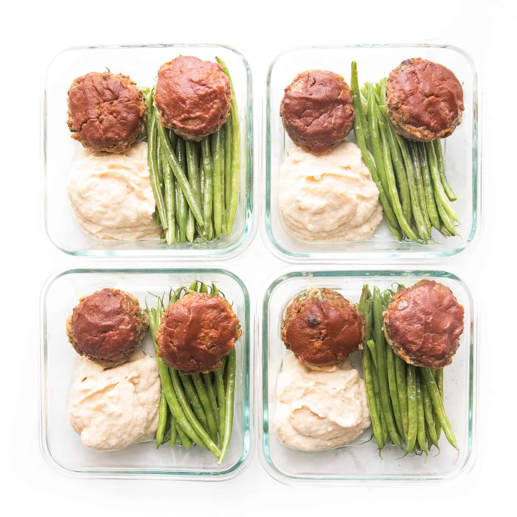 Mini meatloaf muffins topped with ketchup with green beans + mashed cauliflower + green beans in a meal prep container